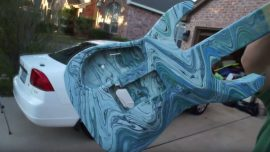 Need to paint a guitar? Get a trash bin full of water and some paint