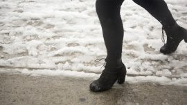 Pennsylvania Commuters Head Out On Foot Amid Storm