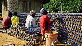 Nigeria Finds An Uncommon Way To Recycle Plastic Bottles, Use Them To Build Houses