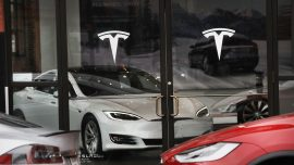 Tesla shares jump to all-time high
