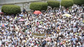 Venezuela opposition marches in silence to honor protest victims