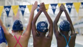 Poor and minority children learn to swim with the help of Olympic champs