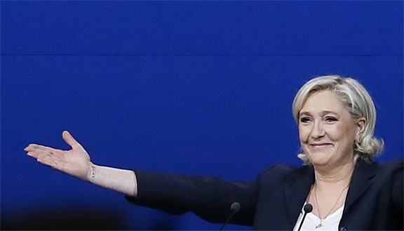French far-right presidential candidate Marine Le Pen arrives at her meeting, Monday May 1, 2017, in Villepinte, outside Paris.  (AP Photo/Francois Mori)