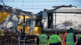 Trains collide in South Africa station, one driver killed