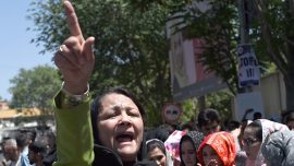 Afghanistan bomb blasts rock funeral for protest victim