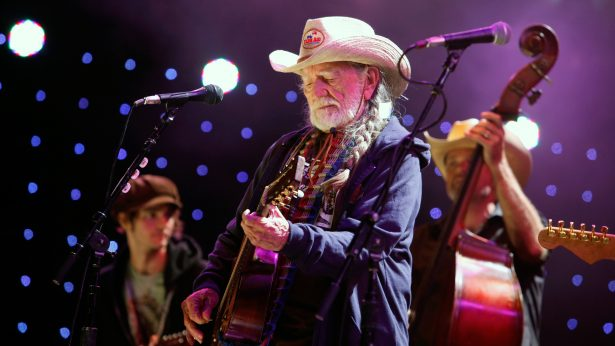 In this Sept. 22, 2012, photo, Willie Nelson performs during the Farm Aid 2012 concert at Hersheypark Stadium in Hershey, Pa. (AP Photo/Jacqueline Larma)