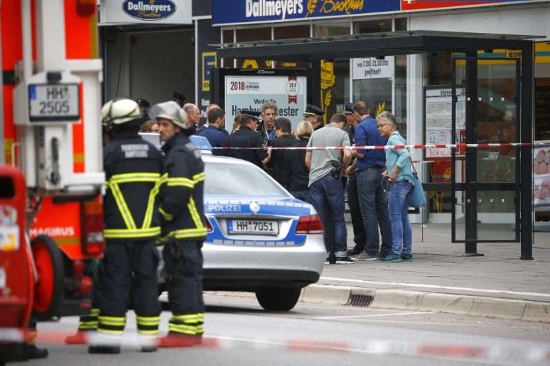 Security forces are seen after a knife attack in a supermarket in Hamburg, Germany, July 28, 2017. (REUTERS/Morris Mac Matzen)