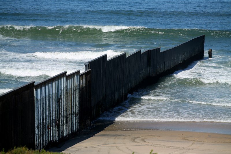 The border fence between the United States and Mexico reaches its most westerly point an ends into the Pacific Ocean at Border Field State Park near San Diego, California, U.S., April 30, 2017. (REUTERS/Mike Blake)