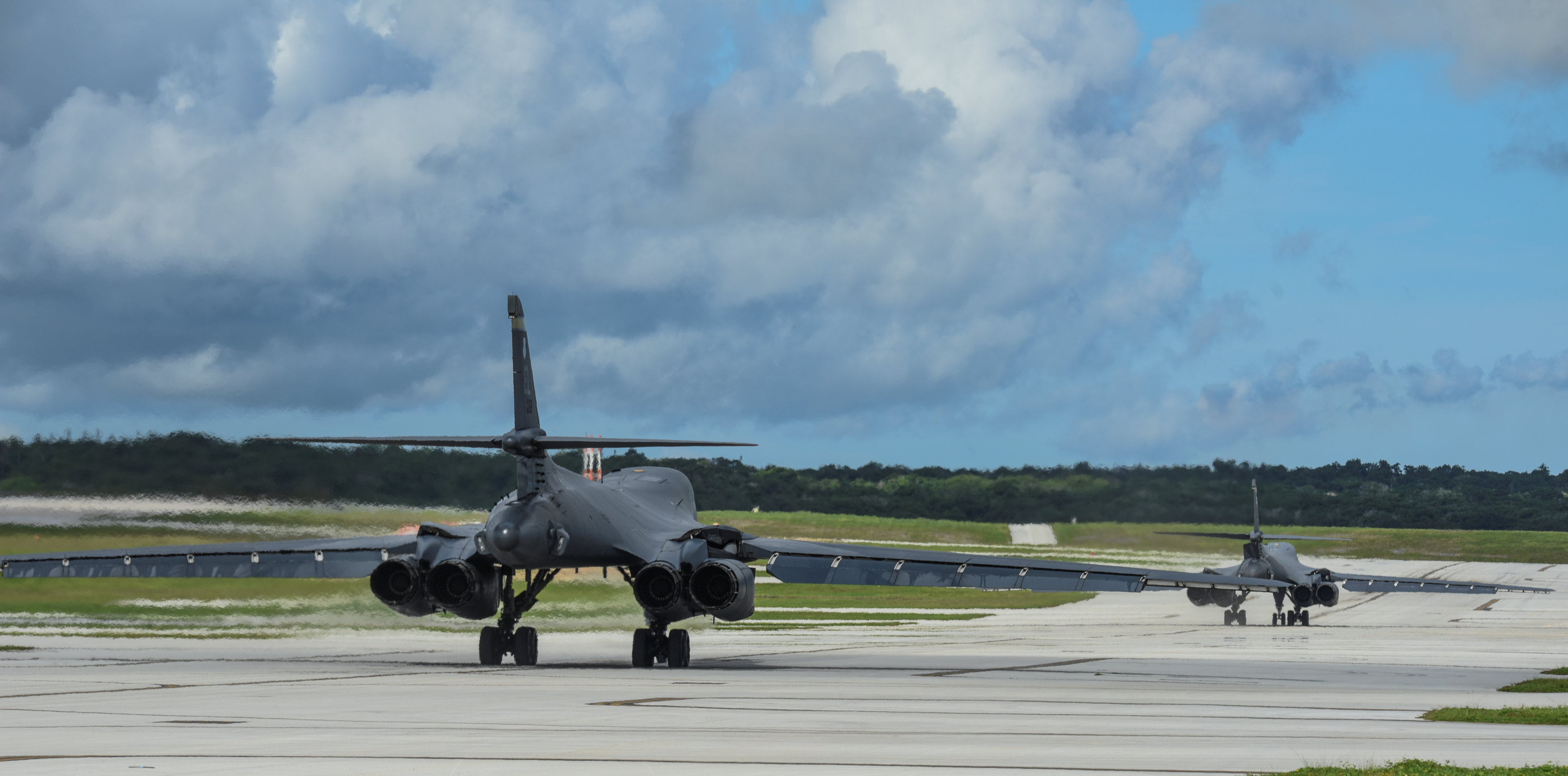 Two U.S. Air Force B-1B Lancer bombers prepare to take off for a 10-hour mission, flying in the vicinity of Kyushu, Japan, the East China Sea, and the Korean peninsula, from Andersen Air Force Base, Guam August 8, 2017. (U.S. Air Force/Tech. Sgt. Richard P. Ebensberger/Handout via REUTERS)