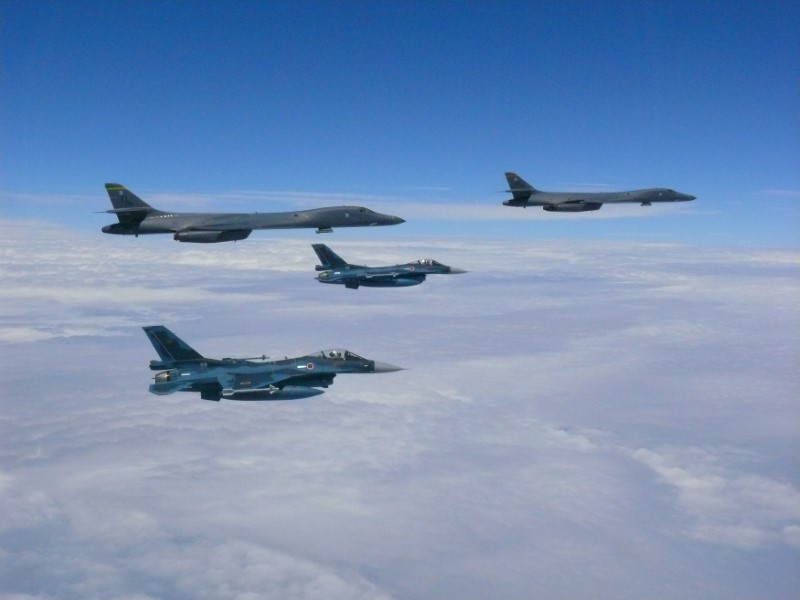 Two U.S. Air Force B-1B Lancer bombers fly from Andersen Air Force Base, Guam, for a 10-hour mission, with an escort of a pair of Japan Self-Defense Forces F-2 fighter jets in the vicinity of Kyushu, Japan August 8, 2017. (U.S. Air Force/Handout via REUTERS)