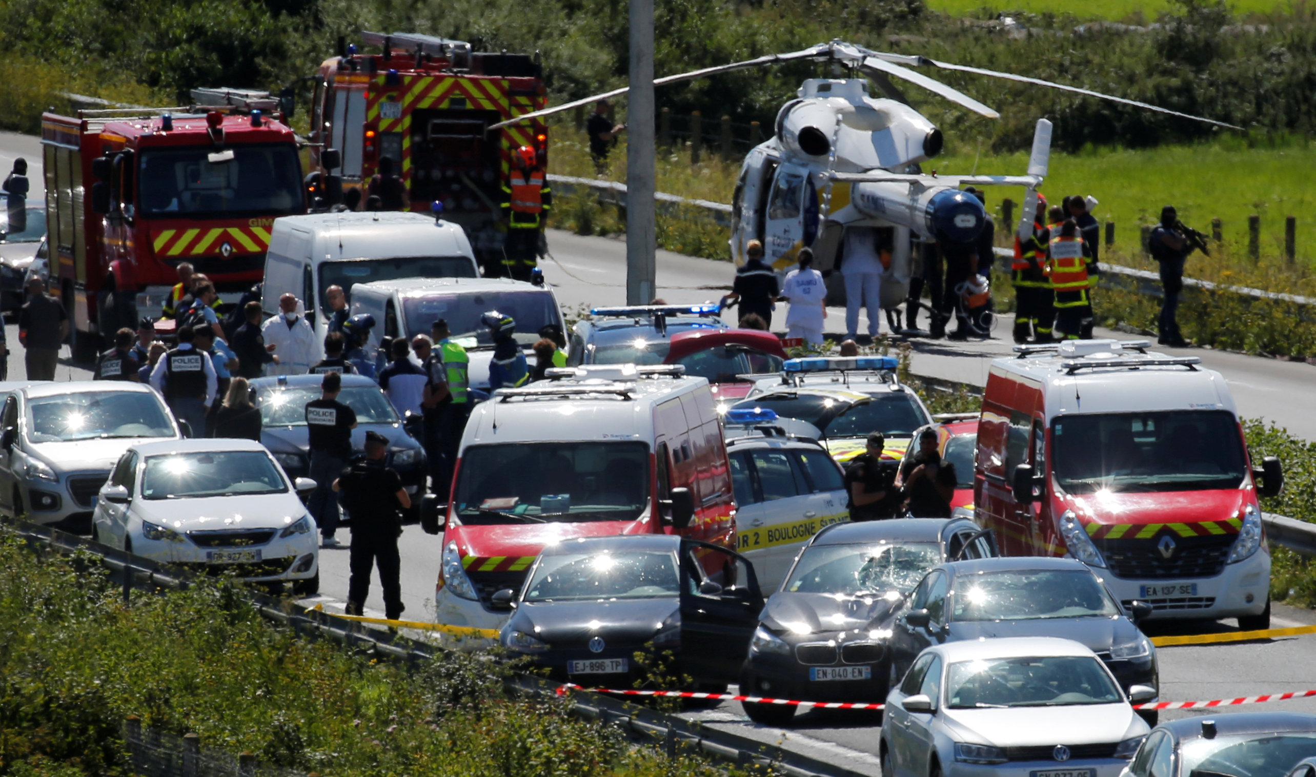 Police and rescue forces are seen on the scene where the man suspected of ramming a car into a group of soldiers on Wednesday in the Paris suburb of Levallois-Perret was shot and arrested on the A16 motorway, near Marquise, France, August 9, 2017. (REUTERS/Pascal Rossignol)