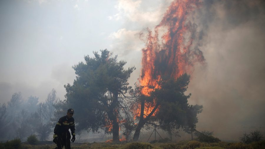 Firefighters battle wildfires near Athens for third day