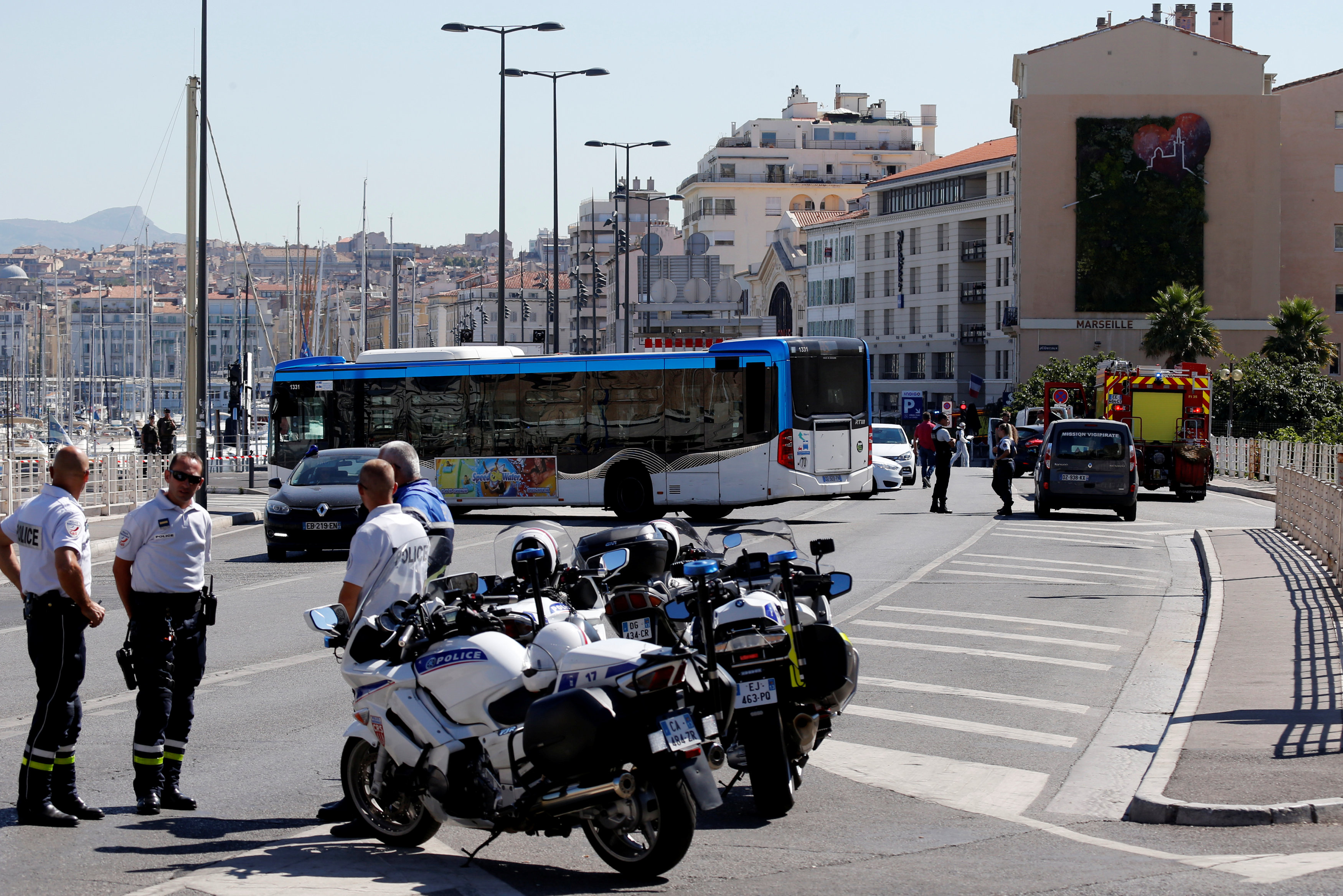 French police secure the area in the French port city of Marseille, France, August 21, 2017 where one person was killed and another injured after a vehicle crashed into two bus shelters, a French police source told Reuters on Monday. REUTERS/Philippe Laurenson