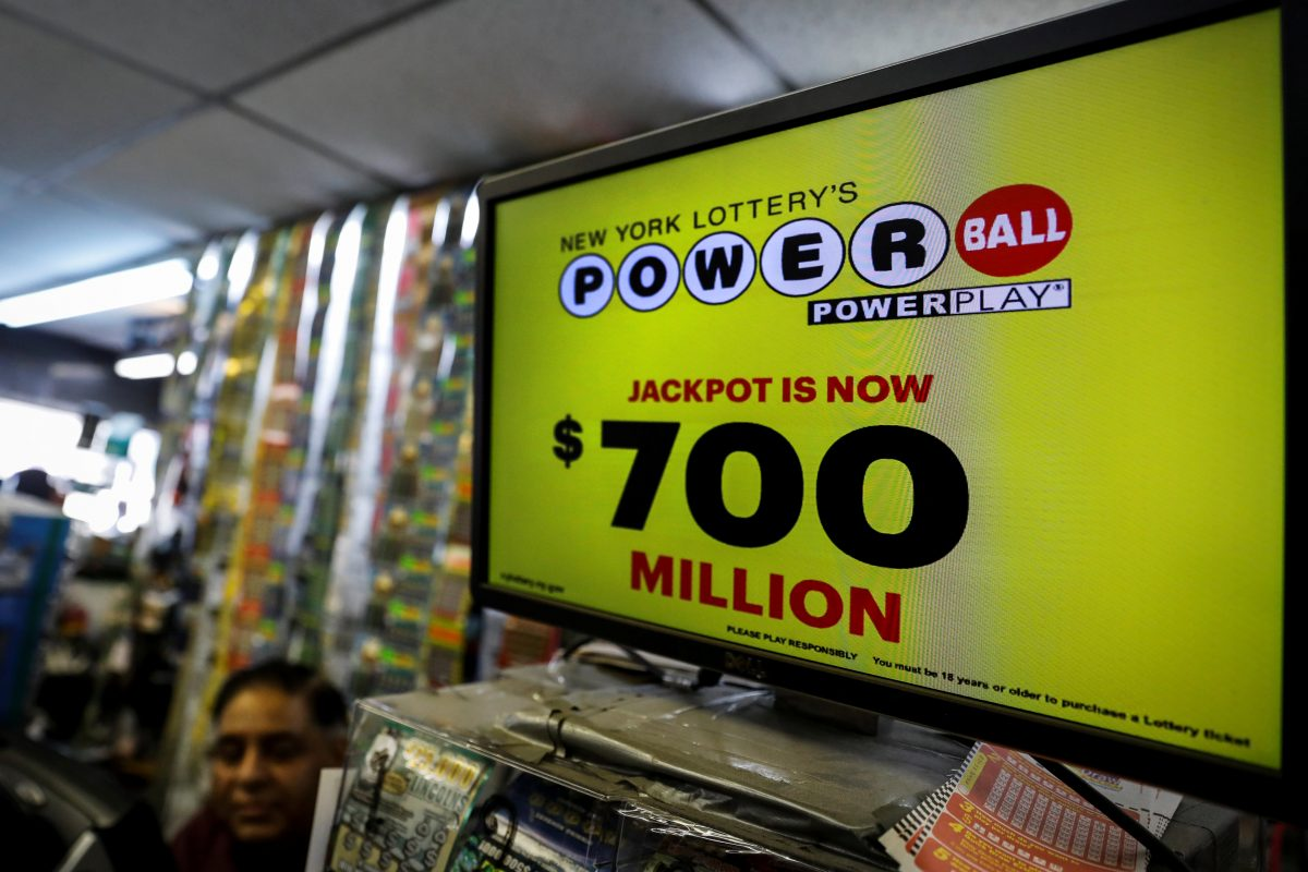 A screen displays the value of the Powerball jackpot at a store in New York City