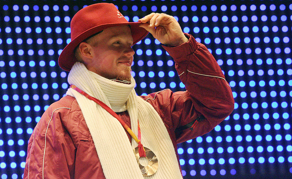 Bronze medallist Latvia's Martins Rubenis celebrates during a 2006 Winter Olympics medal ceremony in Turin, 13 February 2006. (THOMAS COEX/AFP/Getty Images)