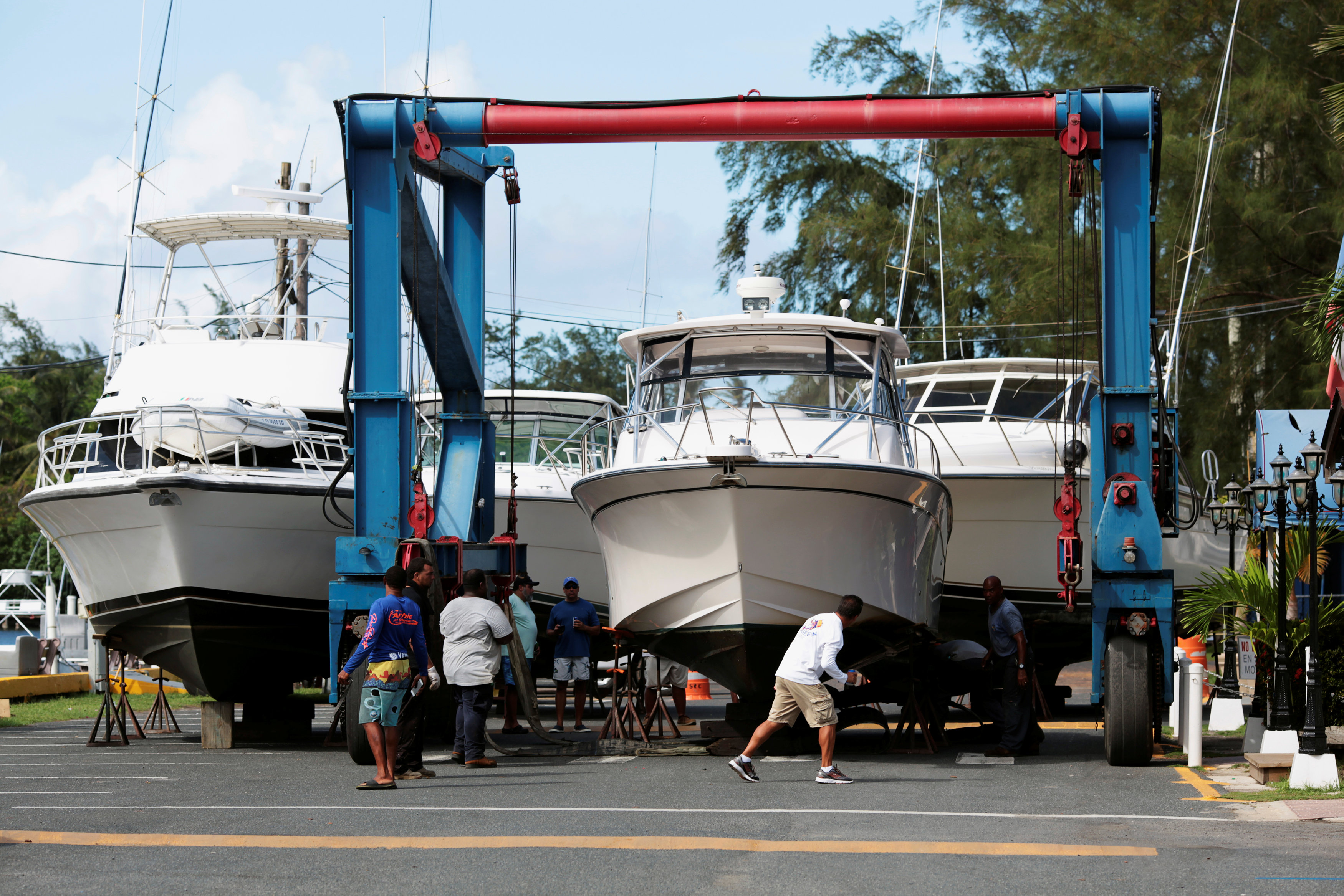 Workers put boats on dry docks in preparation, as Hurricane Irma, barreling towards the Caribbean and the southern United States, was upgraded to a Category 4 storm, in San Juan, Puerto Rico on Sept. 4, 2017. (REUTERS/Alvin Baez)