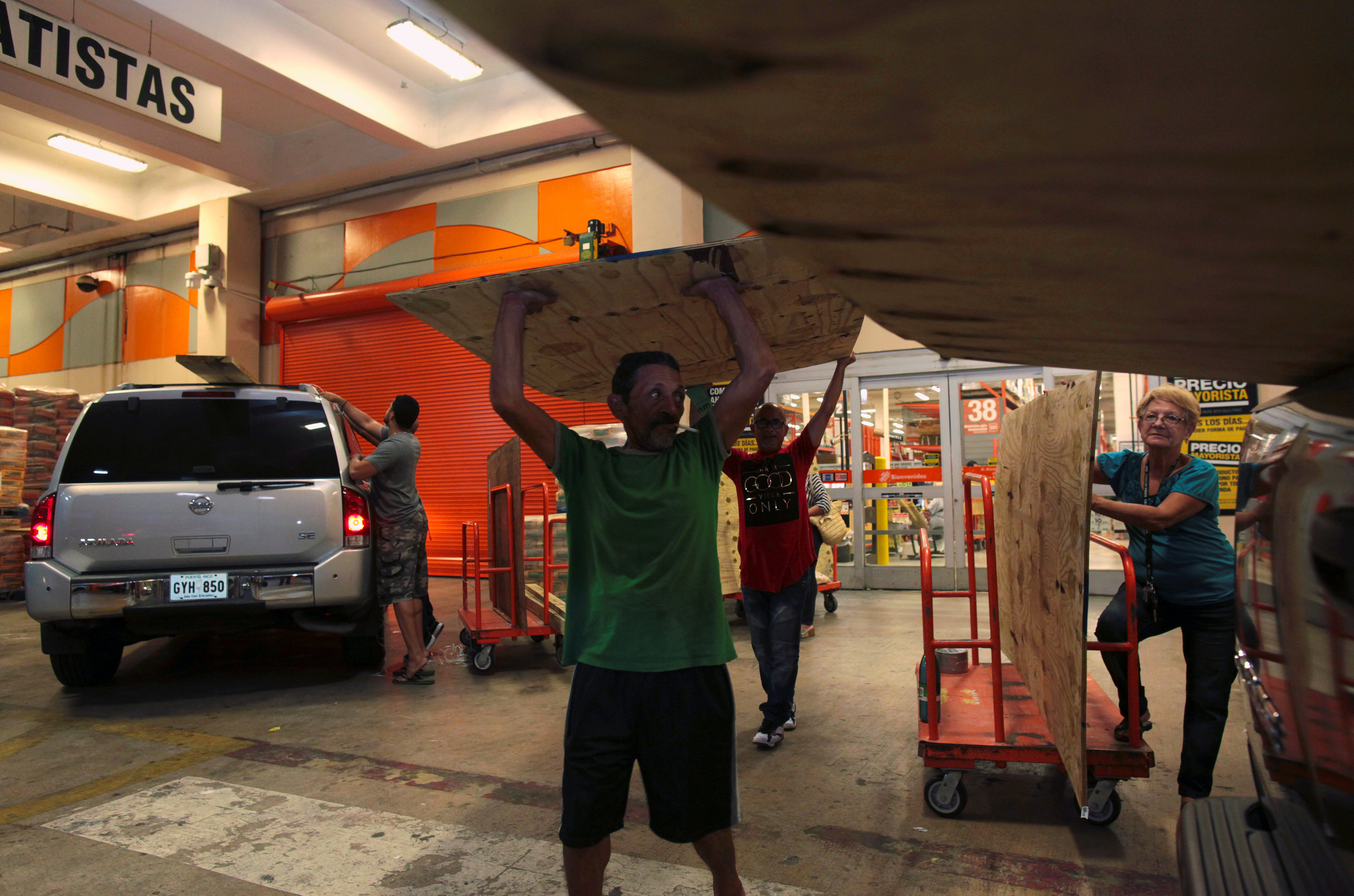 People buy materials at a hardware store after Puerto Rico Governor Ricardo Rossello declared a state of emergency in preparation for Hurricane Irma, in Bayamon, Puerto Rico on Sept. 4, 2017. (REUTERS/Alvin Baez)