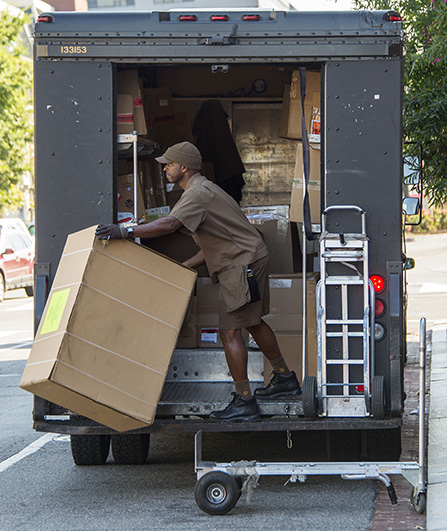 A United Parcel Service employee unloads his truck in Washington, DC, October 6, 2014. (Jim Watson/AFP/Getty Images)