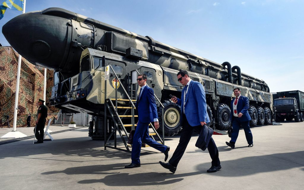 Military specialists walk past a Russian Topol intercontinental ballistic missile (ICBM) at the exposition field in Kubinka Patriot Park outside Moscow on August 22, 2017 during the first day of the International Military-Technical Forum Army-2017. (Alexander Nemenov/AFP/Getty Images)