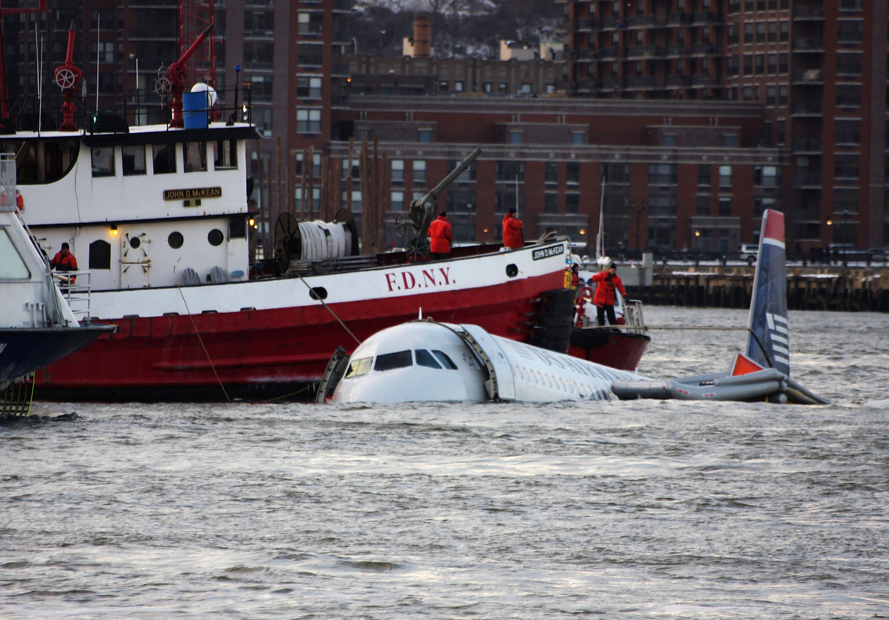 A New York City Fire Department boat floats next to a US Airways plane which crashed into the Hudson River in the afternoon on January 15, 2009 in New York City. (Jerritt Clark/Getty Images)