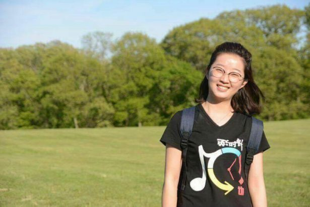 Prosecutors say suspect killed Chinese scholar, then cut her head off