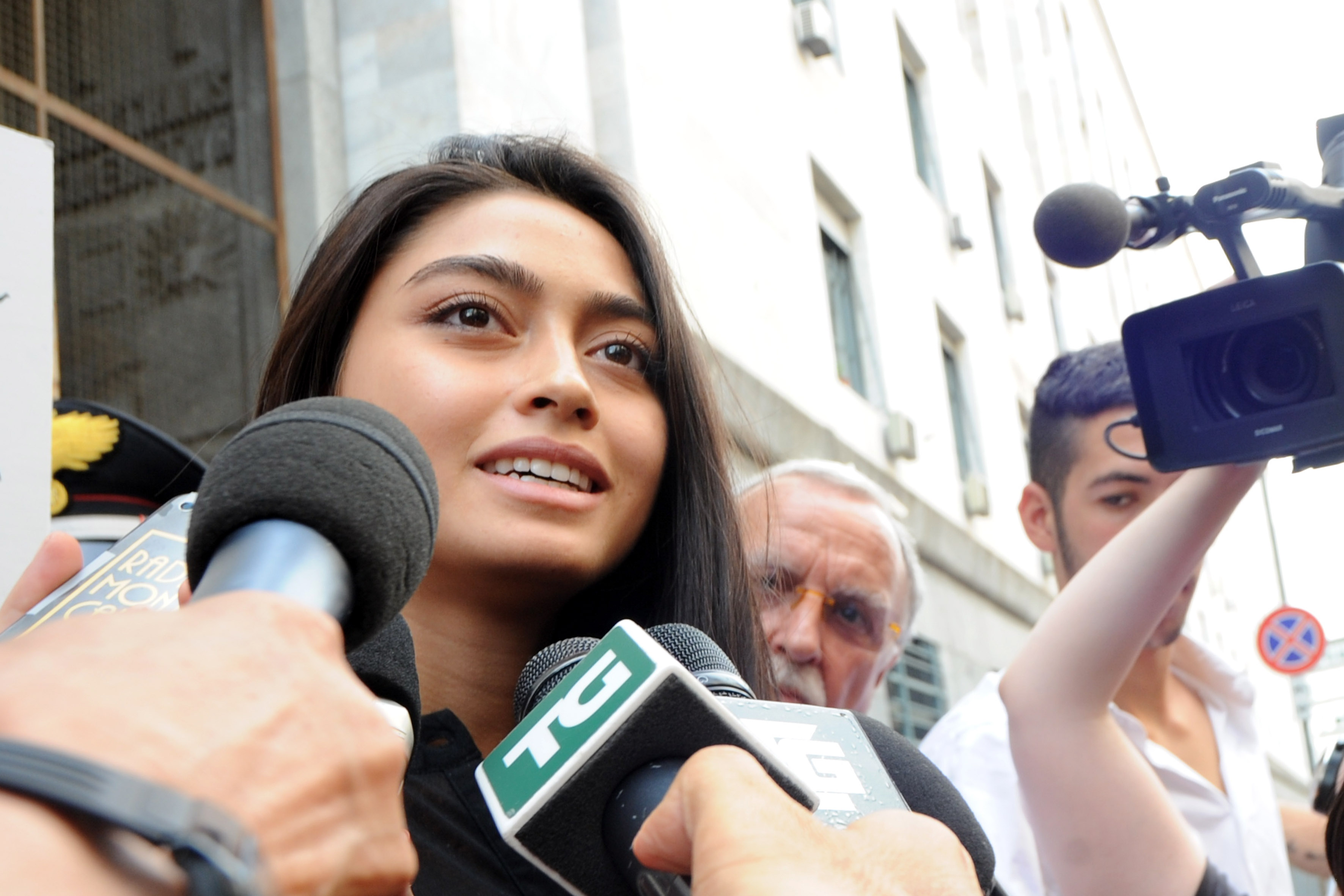 Ambra Battilana speaks to media outside the courthouse on July 19, 2013 in Milan, Italy. (Pier Marco Tacca/Getty Images)