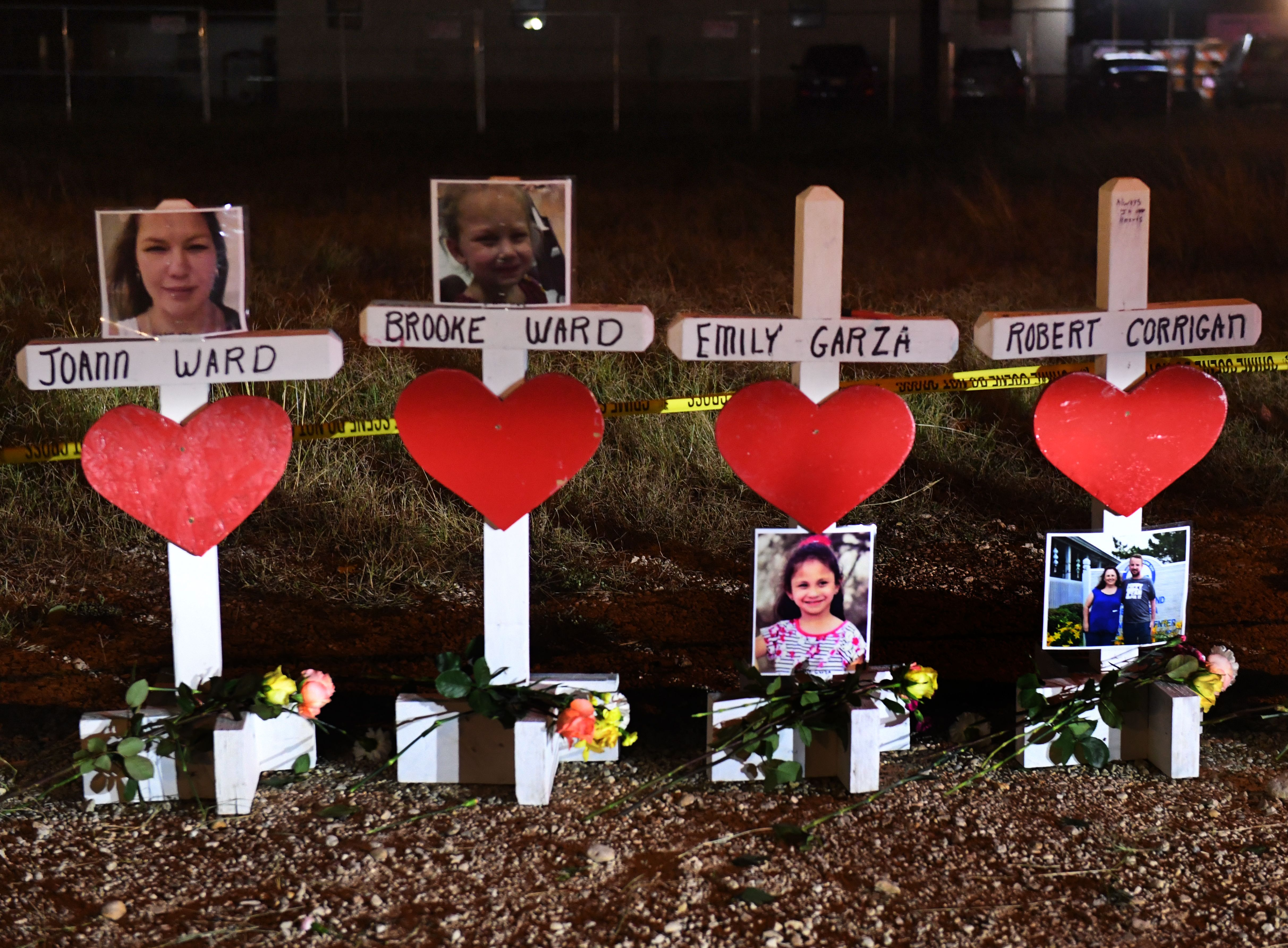 Crosses with the names of victims are seen outside the First Baptist Church which was the scene of the mass shooting that killed 26 people in Sutherland Springs, Texas on November 8, 2017. (Mark Ralston/AFP/Getty Images)