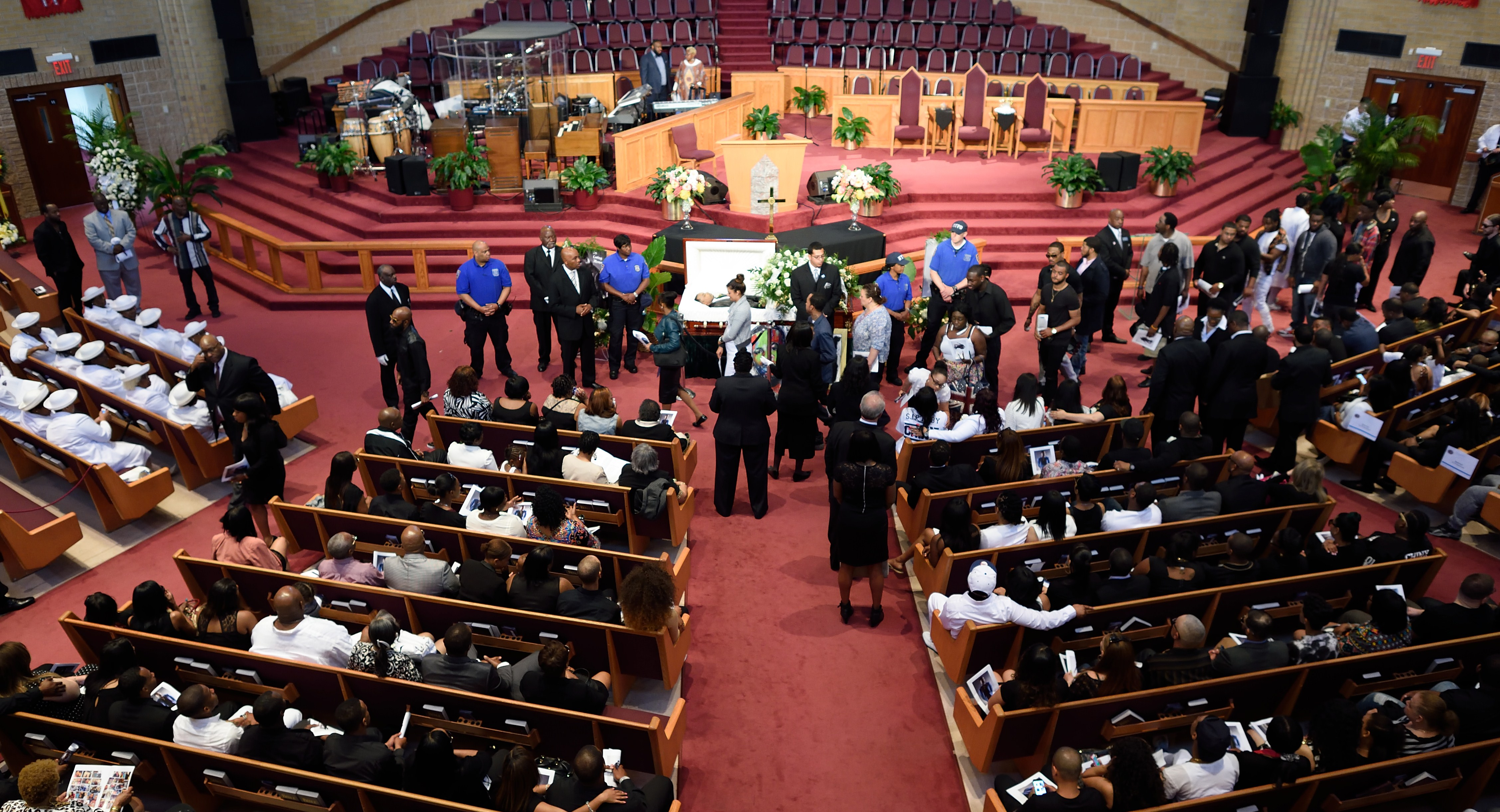 Mourners pass by the body of Rapper Chinx during his wake and funeral at Greater Allen A.M.E church May 26, 2015 in New York., a.k.a. Chinx was killed May 17 in a drive-by shooting in Queens. (Don Emmert/AFP/Getty Images)