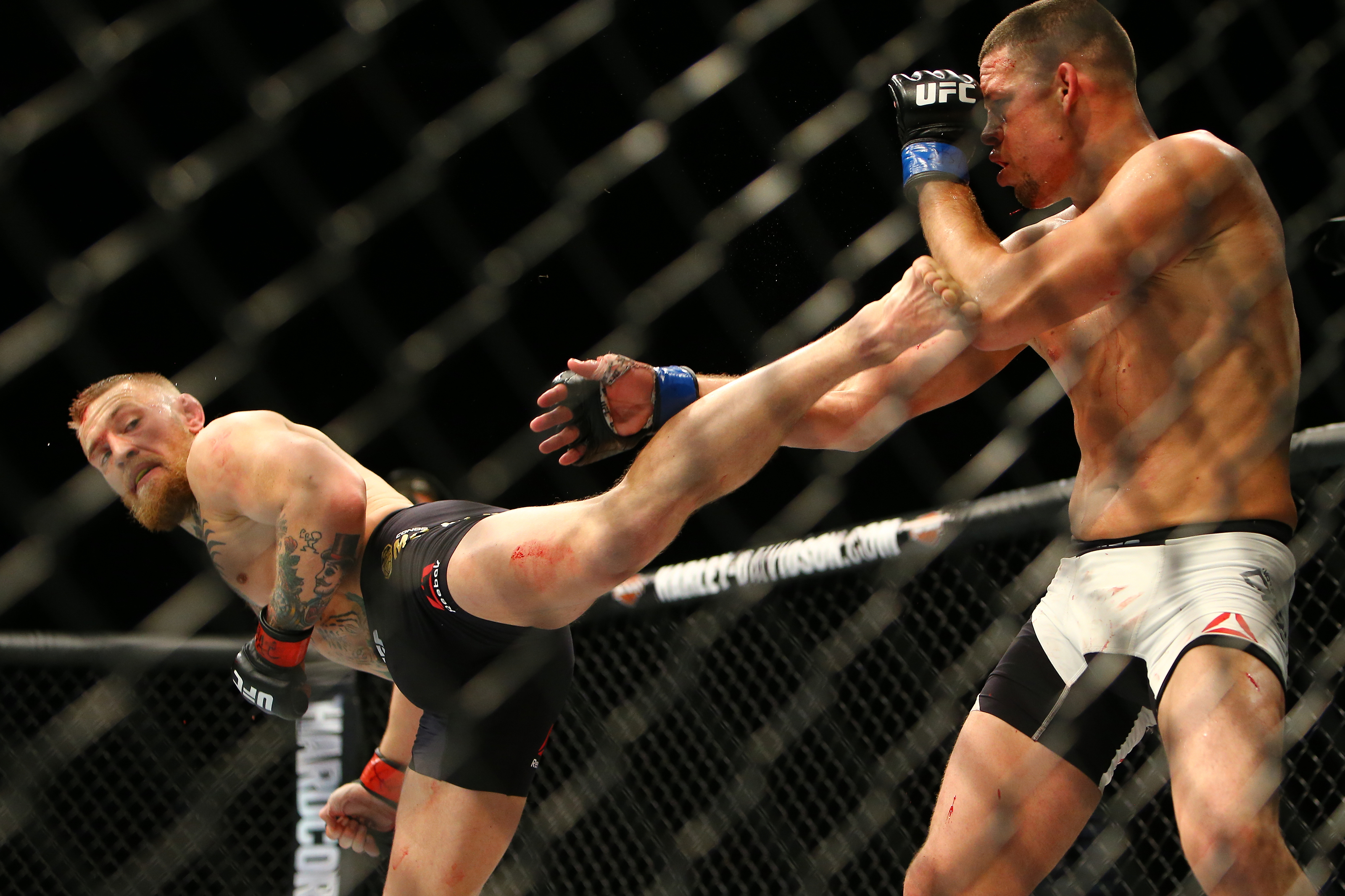Conor McGregor (L) kicks Nate Diaz during UFC 196 on March 5, 2016. (Rey Del Rio/Getty Images)