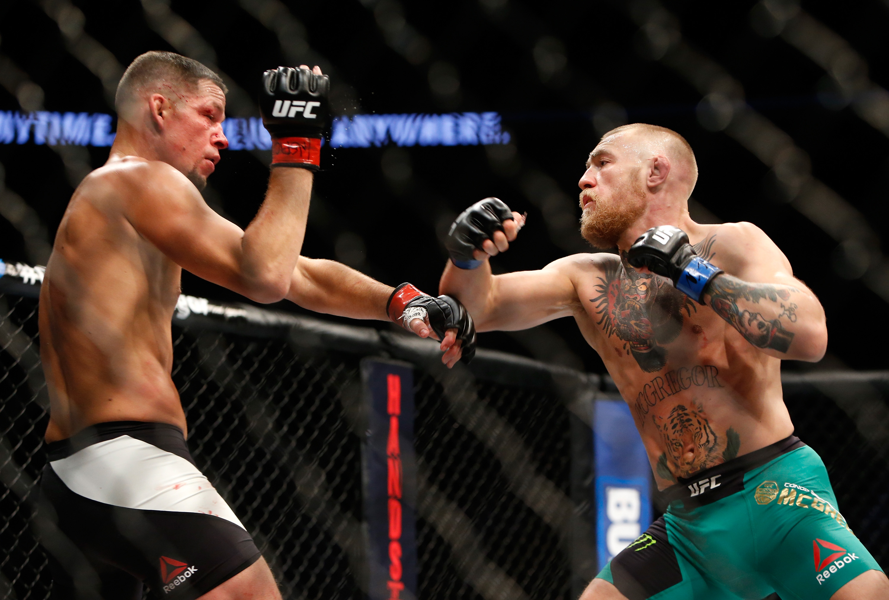 Nate Diaz (L) and Conor McGregor battle during their welterweight rematch at the UFC 202 even, August 20, 2016. (Steve Marcus/Getty Images)