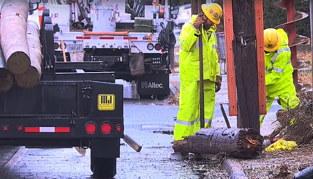 Crews work to repair the downed and damaged power poles broken and snapped by Pittman's crash. (Screenshot WTNH News8/YouTube)