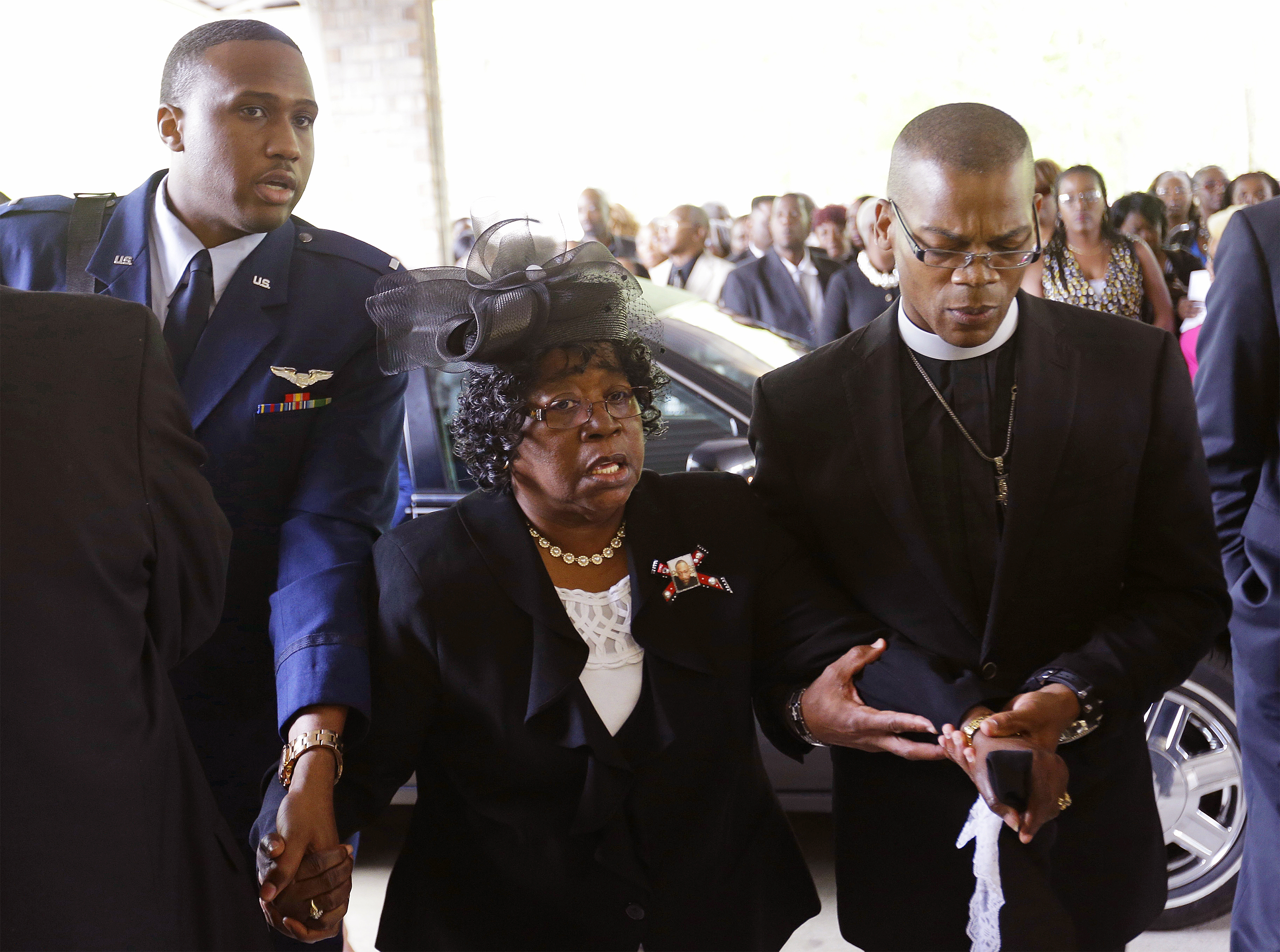 Judy Scott, center, is escorted in for the funeral of her son, Walter Scott, at W.O.R.D. Ministries Christian Center, April 11, 2015 in Summerville, South Carolina. (David Goldman/Getty Images)