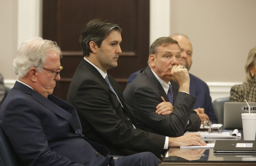 Defense attorneys Andy Savage, left, and Don McCune sit around former North Charleston police officer Michael Slager at theCharleston County court in Charleston, S.C., December 5, 2016. (Grace Beahm/Getty Images)
