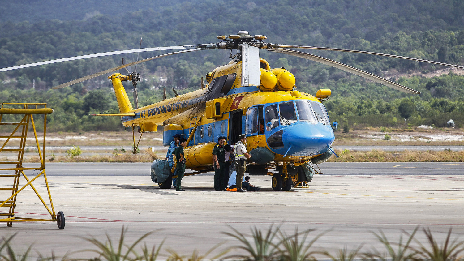 Vietnamese military personnel prepare a helicopter for a search and rescue mission for the missing Malaysia Airlines (MAS) flight MH370 off Vietnam's southern coastline. (Le Quang Nhat/AFP/Getty Images)