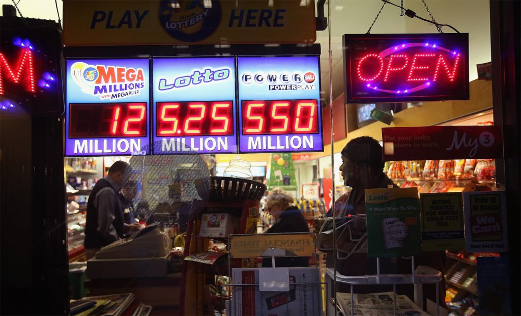 A sign outside the One Stop Mart shows the winning amounts for lottery games including the $550 million for the Powerball jackpot on November 28, 2012 in Chicago, Illinois. (Scott Olson/Getty Images)