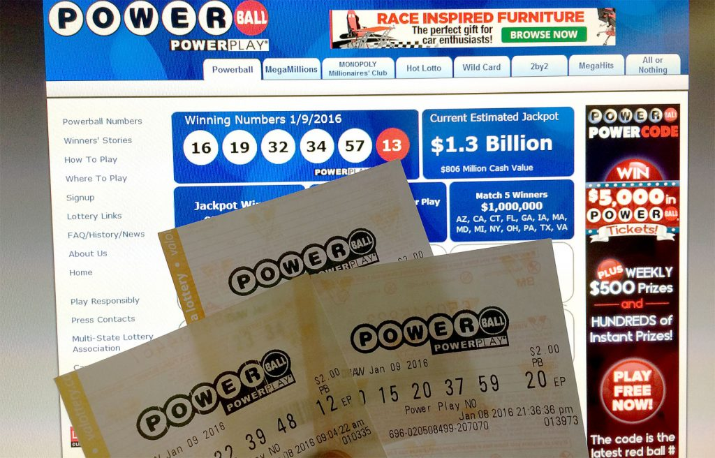 Powerball lottery tickets in front of the splash screen for the powerball.com website, January 10, 2016 (Karen Bleier/AFP/Getty Images)