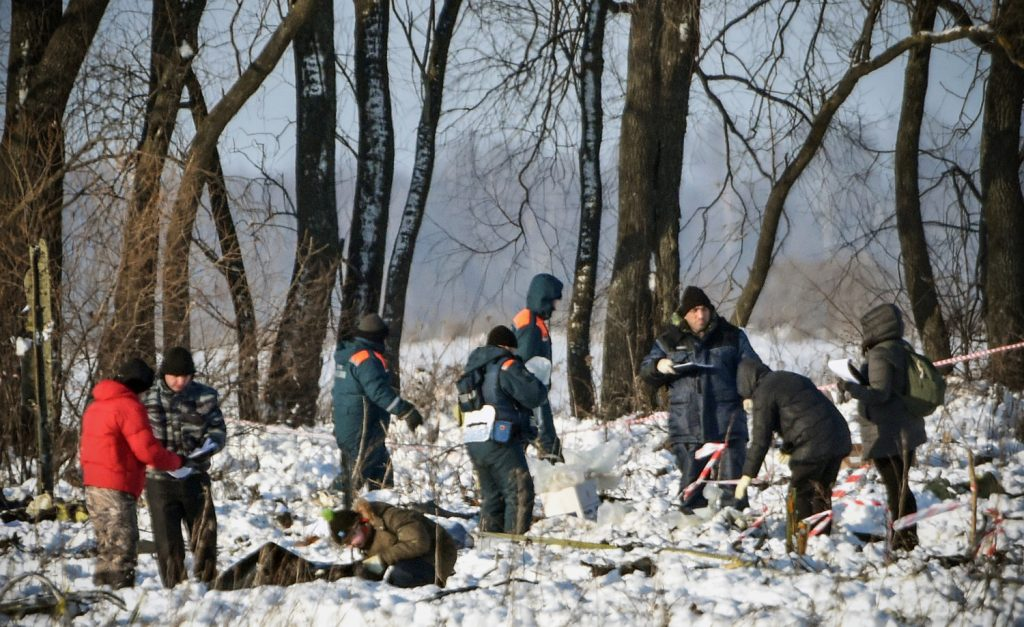 Russian Emergency Ministry rescuers work at the site of a plane crash which occurred the day before in Ramensky district, on the outskirts of Moscow on February 12, 2018 (Vasily Maximov/AFP/Getty Images)