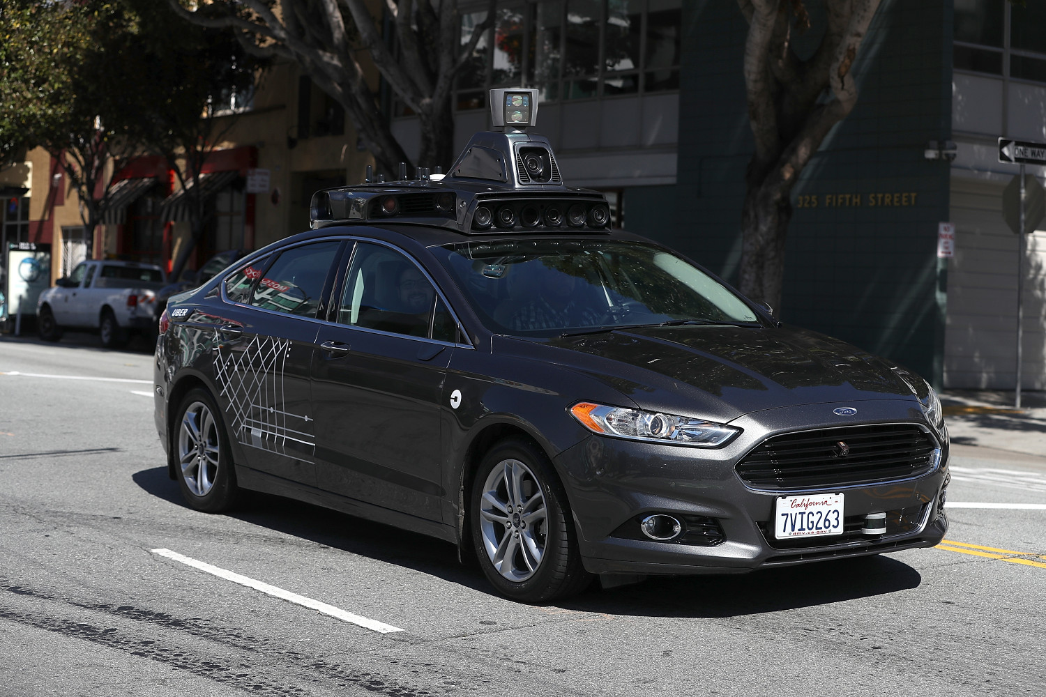 An Uber self-driving car drives down 5th Street on March 28, 2017 in San Francisco, California. Cars in Uber's self-driving cars are back on the roads after the program was temporarily halted following a crash in Tempe, Arizona on Friday. (Justin Sullivan/Getty Images)