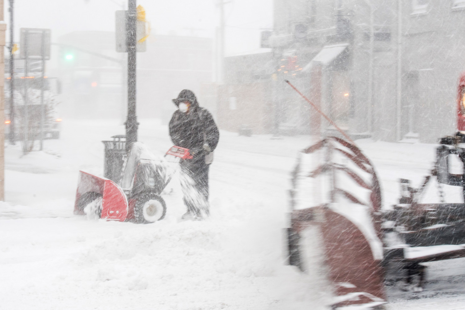 People plow snow in Patchogue, New York as a blizzard hits the Northeastern United States, January 4, 2018. (Andrew Theodorakis/Getty Images)