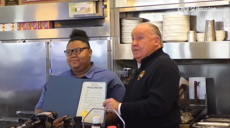 Evoni Williams and Mayor Hocking hold up the proclamation. (Click2Houston screenshot)