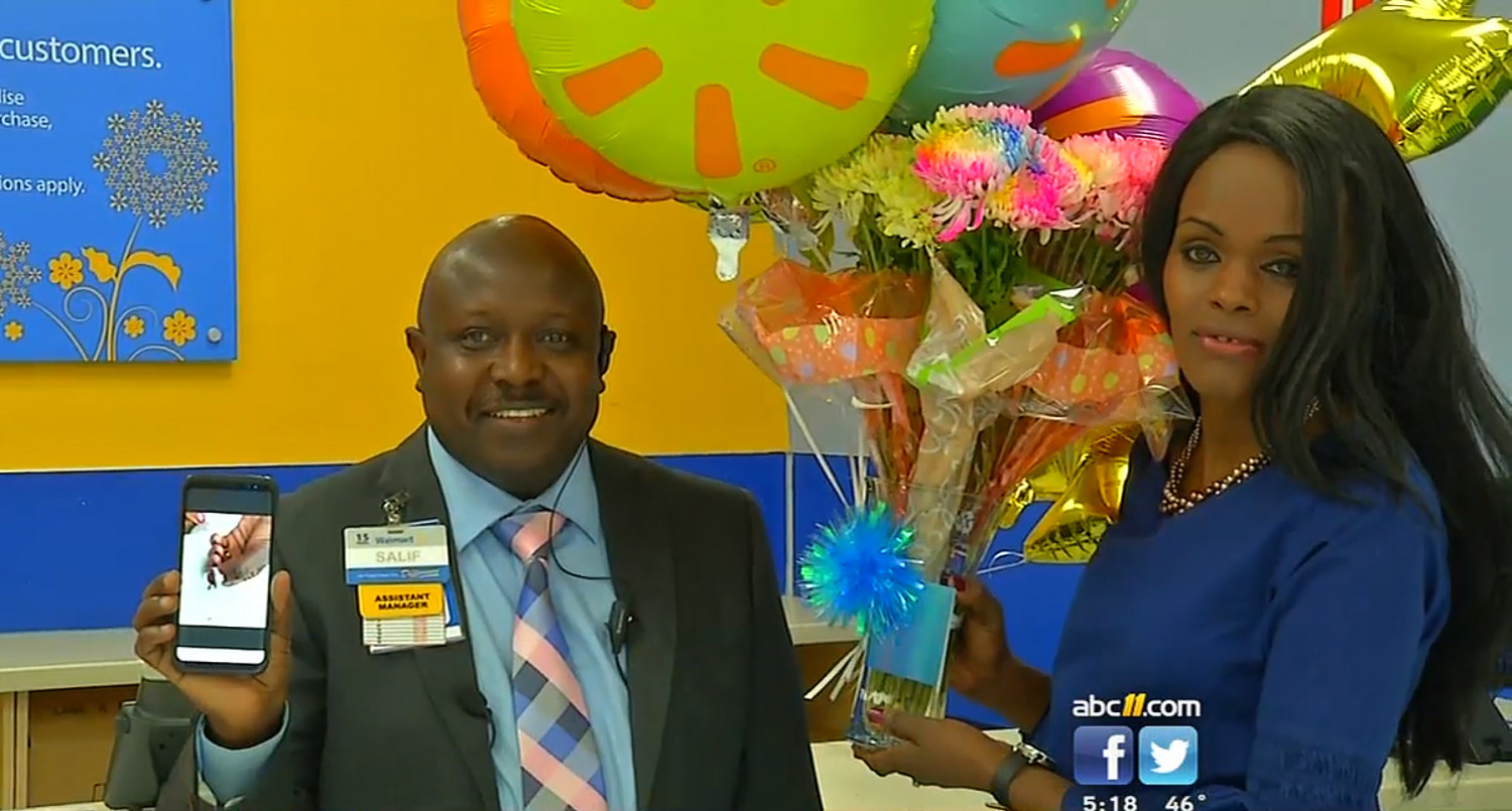 Walmart Assistant Manager Salif Saidy presented Esther Daniel with a 4500 gift card at a small ceremony of appreciation. (ABC11 screentshot)