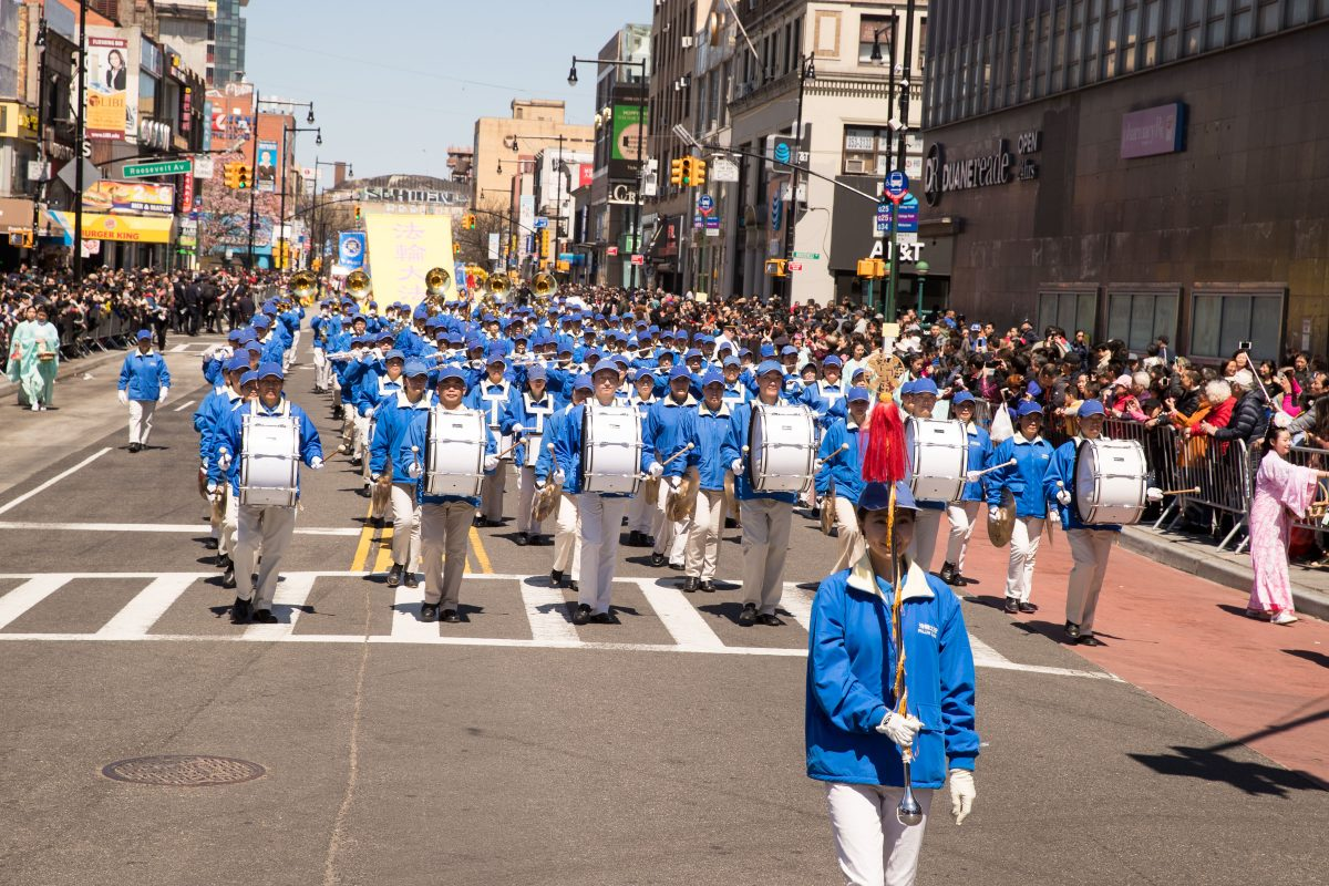 The Tian Guo marching band in a parade in Flushing