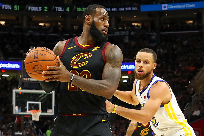 LeBron James is defended by Stephen Curry #30 of the Golden State Warriors during Game Four of the 2018 NBA Finals, June 8, 2018. (Gregory Shamus/Getty Images)