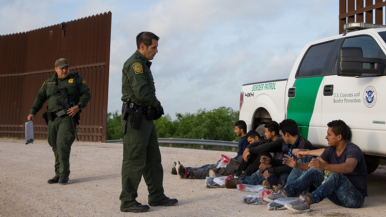Border Patrol agents apprehend illegal immigrants shortly after they crossed the border from Mexico into the United States in the Rio Grande Valley Sector near McAllen, Texas on Monday, March 26, 2018. (Loren Elliott/AFP/Getty Images)