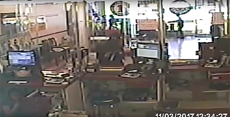 Heavily armed MS-13 gangsters take over a store. (WUSA screenshot)