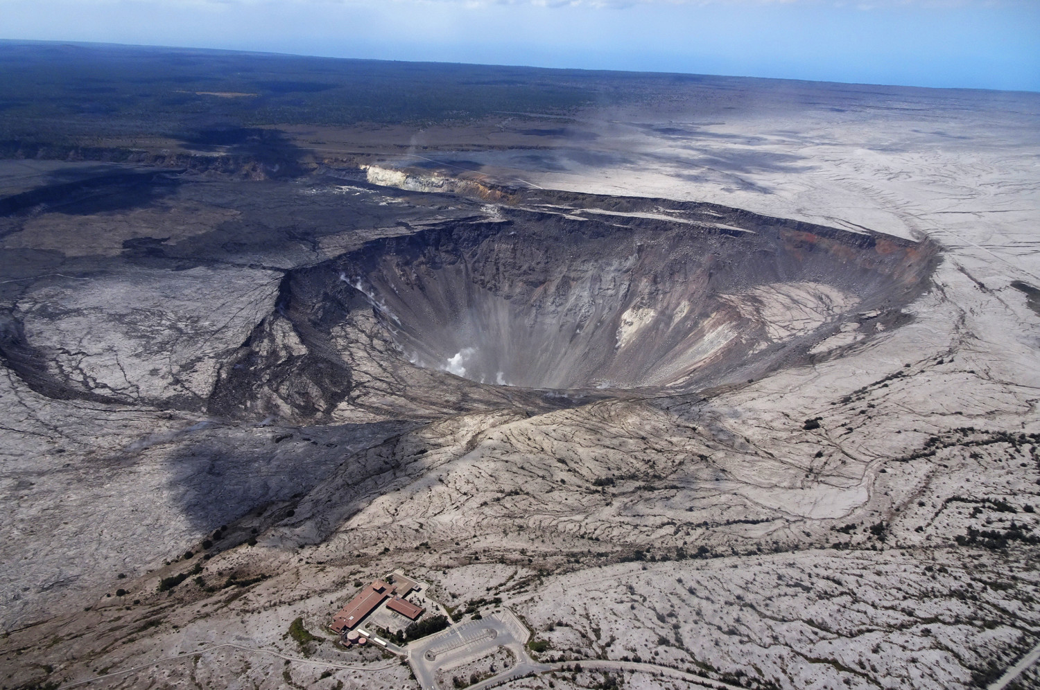 USGS scientists captured this aerial photo of Halema'uma'u and part of the Kīlauea caldera floor during a helicopter overflight of Kīlauea's summit on July 14. (USGS).