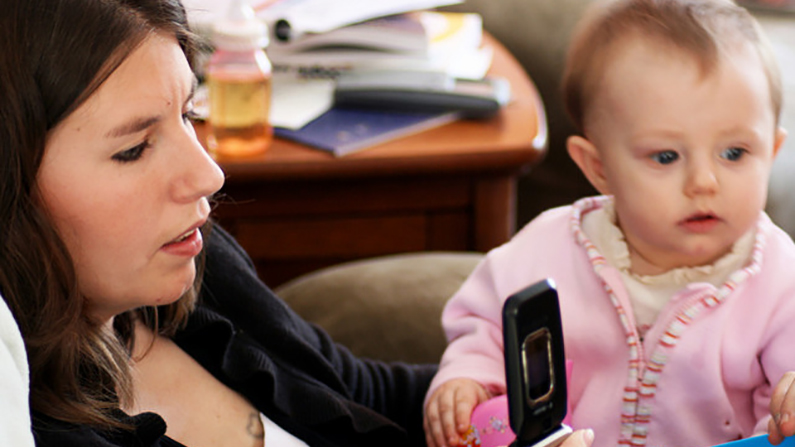 Mothers splitting time between their phones and their children might be making things harder for themselves and their kids. (Quinn Dombrowski/Flickr