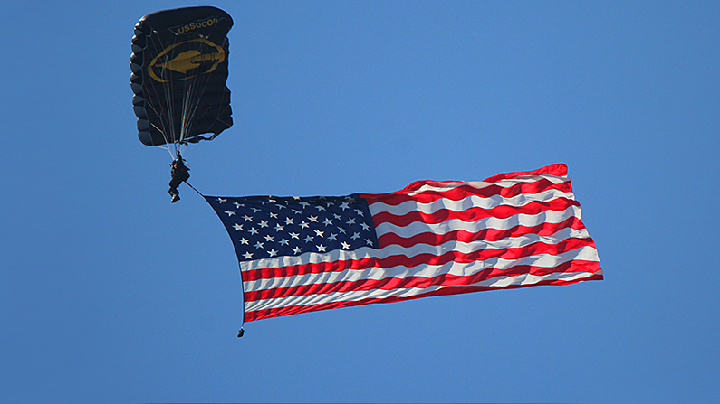 So long as they are displayed respectfully flags can be used as part of a performance. Here a member of the U.S. Army Jump Team descends over Sebring International Speedway before a race. (Chris Jasurek//Epoch Times)