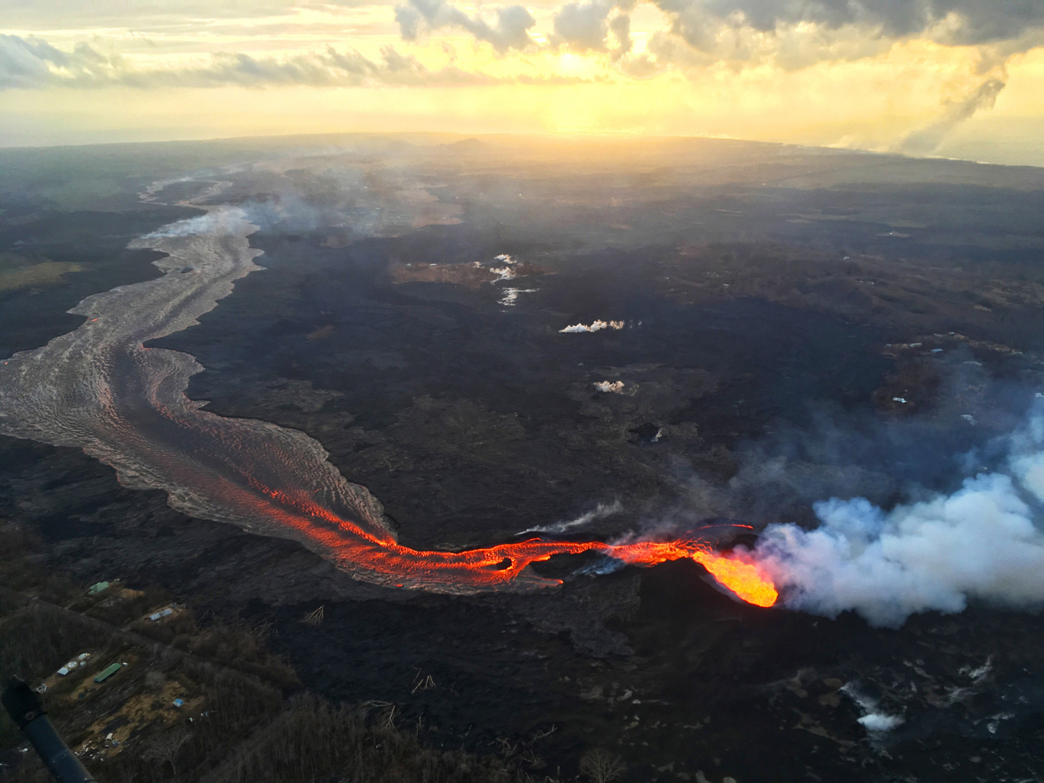 USGS scientists captured this image of sunrise above Kīlauea's lower East Rift Zone. (USGA)