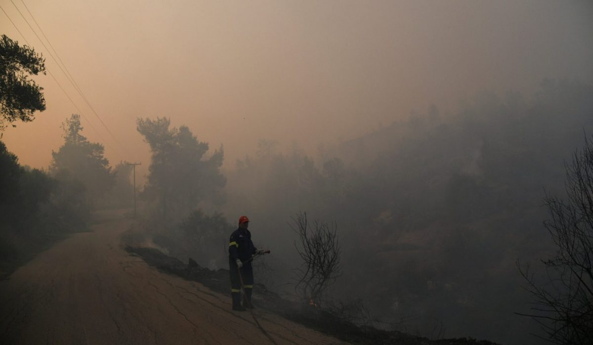 Firefighter fighting wildfire in Evia, Greece